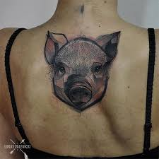 sketch style colored upper back tattoo of little pig head