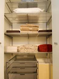 white wooden bathroom closet organizer with shelving unit and