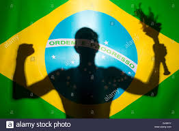Brazil Flag Image Brazilian Athlete Holding Sport Torch In In Silhouette Behind