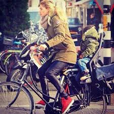 black friday canada goose doutzen kroes in canada goose cycling through amsterdam in her