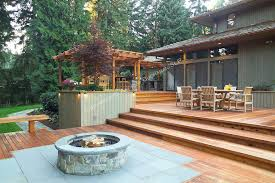 a 1700 square foot 2 level deck outdoor kitchen and firepit