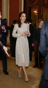 kate middleton dazzles in a glittery dress and sparkly heels as