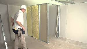how to install a stud wall with insulation and access access
