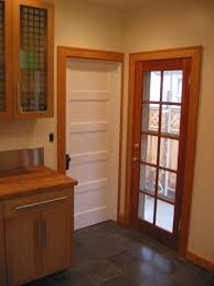 glass entry doors to kitchen backdoor to kitchen and basement