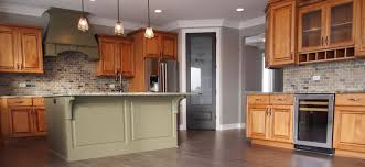granite countertop toffee colored kitchen cabinets tiling a