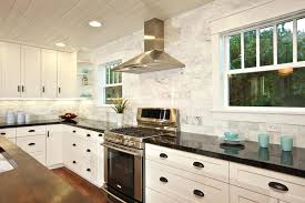 black backsplash in kitchen marble tile backsplash kitchen traditional with black granite image