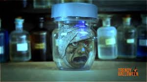 animated mummy head in a jar prop via trendy halloween youtube