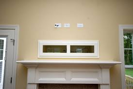 where to put tv where to put cable box with tv over fireplace for stereo