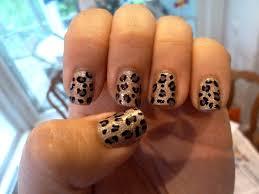 purple polish leopard print nail design
