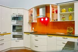kitchen idea of the day modern cream colored kitchen with orange
