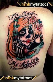 sugar skull with gun on back shoulder