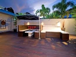 modern landscaping ideas for small backyards wooden deck with modern furniture using umbrella for inexpensive
