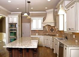 gourmet kitchen love the antique white cabinets with chocolate