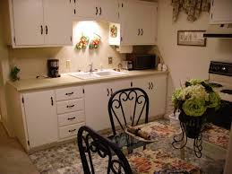 even a small cozy apartment kitchen is spruced up with silk roses
