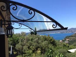 pensilina tettoia in policarbonato plexiglass bellhouse coperture realizzazione pensiline e arredo giardino su