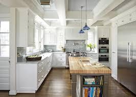 butcher block island kitchen traditional with dark floor metal pot