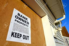 real estate lender bank owned keep out sign notice posted on