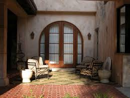 home design interior arched french doors concrete landscape