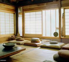 japanese room with floor pillows budda statueand rice paper
