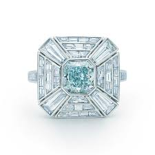 art deco ring in platinum with a 1 20 carat fancy greenish blue