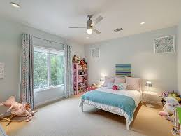 pink and blue bedroom with pink bookcase contemporary