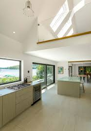 modern cottage kitchen modern lake cottage with nordic inspired design in saint donat canada