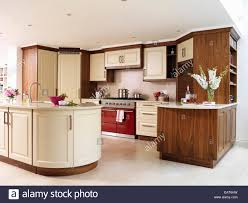 contemporary kitchen with central island unit and range oven stock