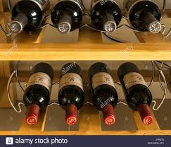 rows of horizontal red wine bottles from bordeaux france laid down