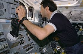 sts 77 crewmembers photographed working with rms controls nasa