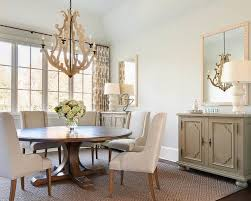 white and gray dining room with gray mirrored buffet cabinet