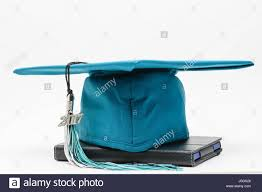 graduation cap and tassel graduation cap and tassel sits on top of technology stock photo