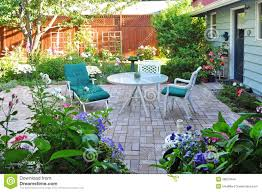 view of flower garden and backyard patio area stock photo image