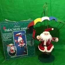 telco holiday decor musical parachute santa christmas display