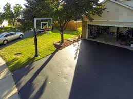 the pro dunk gold sits next to a typical two car garage using the
