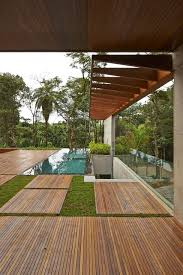 Pool With Pergola by Architecture Awesome Green Vegetation And Pool With Wooden Panel