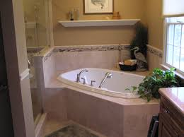 bathroom white japanese soaking tub with marble wainscoting and