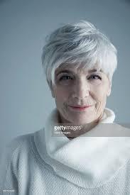 short white hair portrait confident caucasian senior woman with short white hair