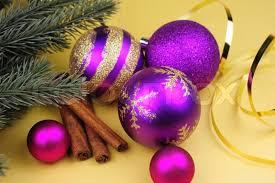 purple balls of various sizes cinnamon sticks twig