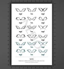 100 wrist wing tattoos wing tattoos on wrist photo 14