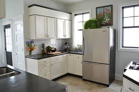 space between top of refrigerator and cabinet ideas for using that awkward space above the fridge apartment therapy