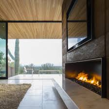 modern glass fireplace and white marble bench under wall mounted