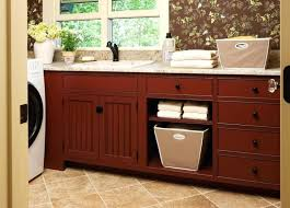 bathroom cabinet with built in laundry her laundry laundry room basket cabinets in conjunction with laundry