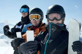 winter sport friends showing ski lift pass smiling concept to
