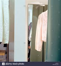 pink jacket in fitting room stock photo royalty free image