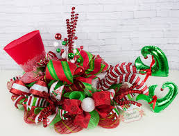 elf centerpiece christmas centerpiece elf legs decor top
