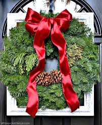 wreath for front door framed christmas wreath and front porch decor at the picket fence