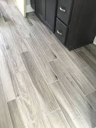 newly installed gray weathered wood plank tile flooring mudroom