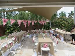 tables and chairs setup for backyard bbq utilizing burlap red