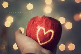 image of an apple with a heart sign curved on it