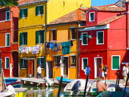 painted houses burano venice painted houses with hanging laundry sea canal a